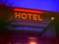 Hotel black trough lettering with outline neon lettering
